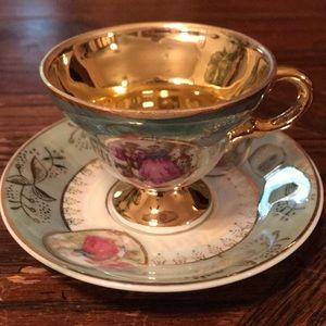 Iridescent demitasse pedestal teacup with saucer